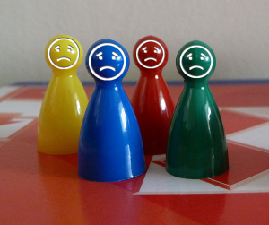 Sad game pieces on a gameboard